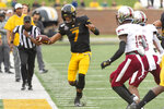 Missouri quarterback Kelly Bryant, left, runs for a first down during the second quarter of an NCAA college football game against Troy Saturday, Oct. 5, 2019, in Columbia, Mo. (AP Photo/L.G. Patterson)