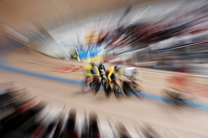 Athletes compete during the track cycling women's keirin at the 2020 Summer Olympics, Wednesday, Aug. 4, 2021, in Izu, Japan. (AP Photo/Thibault Camus)