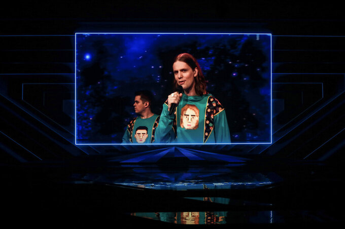 Dadi og Gagnamagnid from Iceland perform via video link during rehearsals at the Eurovision Song Contest at Ahoy arena in Rotterdam, Netherlands, Wednesday, May 19, 2021. A member of Dadi og Gagnamagnid tested positive for COVID-19 and the band made the decision to withdraw from performing in this year's live Eurovision Song Contest shows, as they only want to perform together as a group. (AP Photo/Peter Dejong)