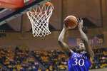 Kansas guard Ochai Agbaji shoots against West Virginia during the first half of an NCAA college basketball game Wednesday, Feb. 12, 2020, in Morgantown, W.Va. (AP Photo/Kathleen Batten)