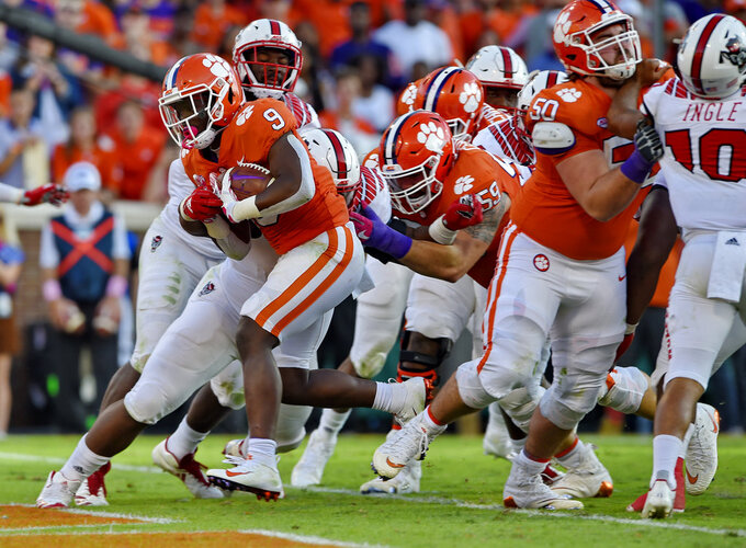 Clemson's Travis Etienne rushes in for a touchdown during the second half of an NCAA college football game against North Carolina State Saturday, Oct. 20, 2018, in Clemson, S.C. (AP Photo/Richard Shiro)