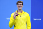Brendon Smith, of Australia, poses with his bronze medal on the podium after the men's 400-meter individual medley at the 2020 Summer Olympics, Sunday, July 25, 2021, in Tokyo, Japan. (AP Photo/Matthias Schrader)