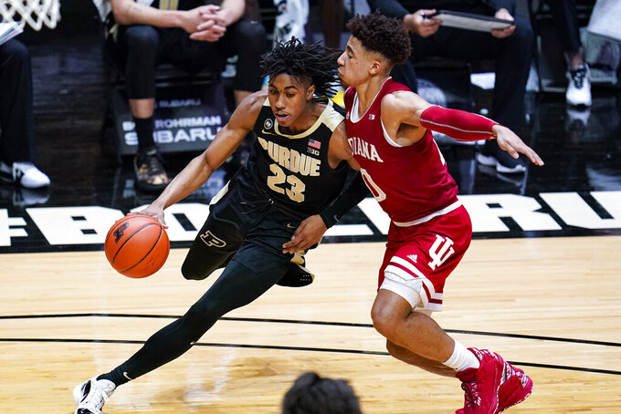 Purdue guard Jaden Ivey, left, drives around Indiana guard Rob Phinisee, right,  during the second half of an NCAA college basketball game in West Lafayette, Ind., Saturday, March 6, 2021. (AP Photo/Michael Conroy)