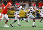Georgia defensive back Christopher Smith intercepts a pass intended for Clemson wide receiver Justyn Ross and returns it for a touchdown during the second quarter of an NCAA college football game Saturday, Sept. 4, 2021, in Charlotte, N.C. (Curtis Compton/Atlanta Journal-Constitution via AP)