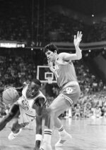 File-This March 23, 1984, file photo shows North Carolina forward Michael Jordan, trying to drive past Indiana forward Mike Giomi at Omni Coliseum in Atlanta Ga. It's well-known that Jordan uses failure to motivate him. The only thing seemingly that has eluded the 55-year-old Jordan is ultimate success as an executive and team owner. His Hornets have yet to win a playoff series since he took over as majority owner nine years ago and they remain marred in NBA mediocrity while struggling to compete in a small market. But Jordan wants to keep his team, and the city,  relevant. It's one reason he aggressively pursued the All-Star game with such vigor.  (AP Photo/H. Joe Holloway, File)