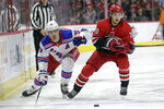 New York Rangers center Chris Kreider, left, and Carolina Hurricanes right wing Sebastian Aho, of Finland, skate during the first period of an NHL hockey game in Raleigh, N.C., Thursday, Nov. 7, 2019. (AP Photo/Gerry Broome)