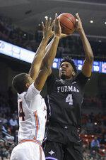 Furman forward Noah Gurley (4) shoots over Auburn forward Anfernee McLemore (24) during the first half of an NCAA college basketball game Thursday, Dec. 5, 2019, in Auburn, Ala. (AP Photo/Julie Bennett)