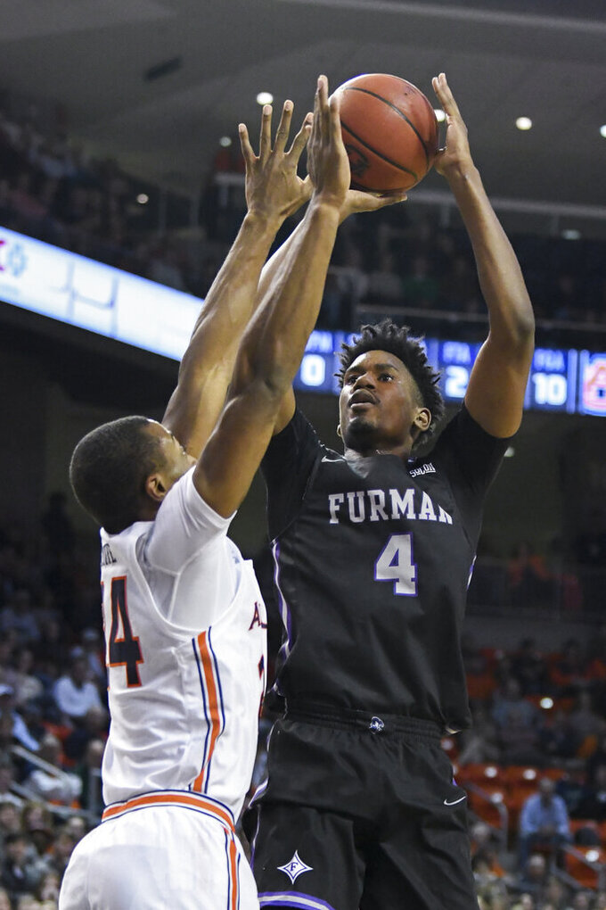 Furman forward Noah Gurley (4) shoots over Auburn forward Anfernee McLemore (24) during the first half of an NCAA college basketball game Thursday, Dec. 5, 2019, in Auburn, Ala. (AP Photo/Julie Bennett)
