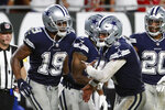 Dallas Cowboys quarterback Dak Prescott (4) celebrates with wide receiver Amari Cooper (19) after Cooper caught a 21-yard touchdown reception during the second half of an NFL football game against the Tampa Bay Buccaneers Thursday, Sept. 9, 2021, in Tampa, Fla. (AP Photo/Scott Audette)