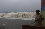 A woman watches waves splash on shores of the Arabian Sea in Mumbai, India, Wednesday, June 3, 2020. A storm in the Arabian Sea off India's west coast intensified into a severe cyclone on Wednesday, gathering speed as it barreled toward India's financial capital of Mumbai. Nisarga was forecast to drop heavy rains and winds gusting up to 120 kilometers (75 miles) per hour when it makes landfall Wednesday afternoon as a category 4 cyclone near the coastal city of Alibagh, about 98 kilometers (60 miles) south of Mumbai, India's Meteorological Department said. (AP Photo/Rafiq Maqbool)
