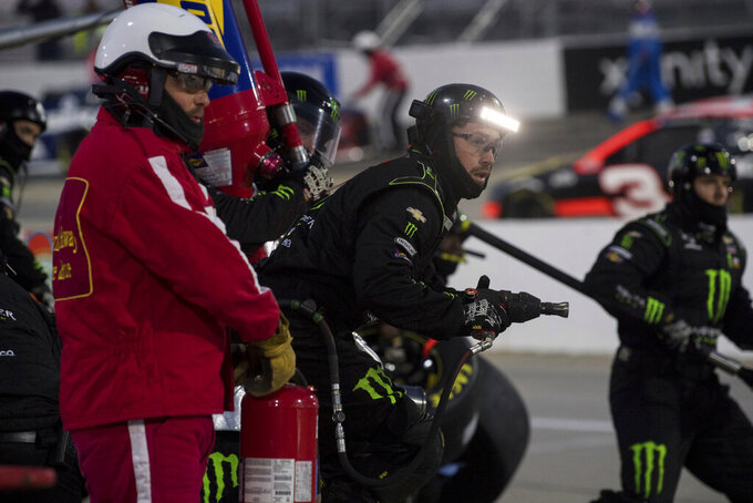 Pit crew for Kurt Busch (1) sets to work on car during a NASCAR Cup Series auto race at the Martinsville Speedway in Martinsville, Va., Sunday, Nov.1, 2020. (AP Photo/Lee Luther Jr.)