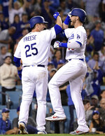 Los Angeles Dodgers' Cody Bellinger, right, is congratulated by David Freese after hitting a two-run home run during the seventh inning of a baseball game against the San Francisco Giants Wednesday, June 19, 2019, in Los Angeles. (AP Photo/Mark J. Terrill)