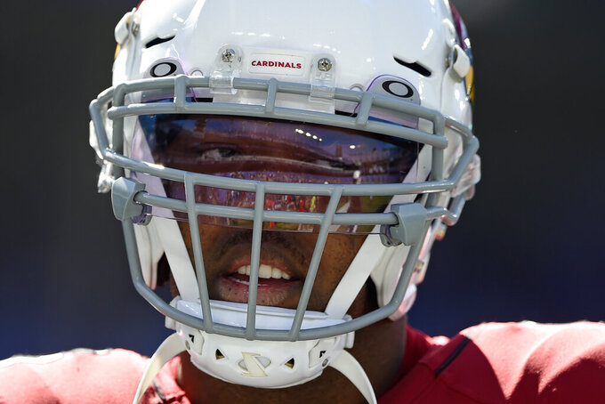 Arizona Cardinals outside linebacker Terrell Suggs warms up before an NFL football game against the Baltimore Ravens, Sunday, Sept. 15, 2019, in Baltimore. (AP Photo/Gail Burton)