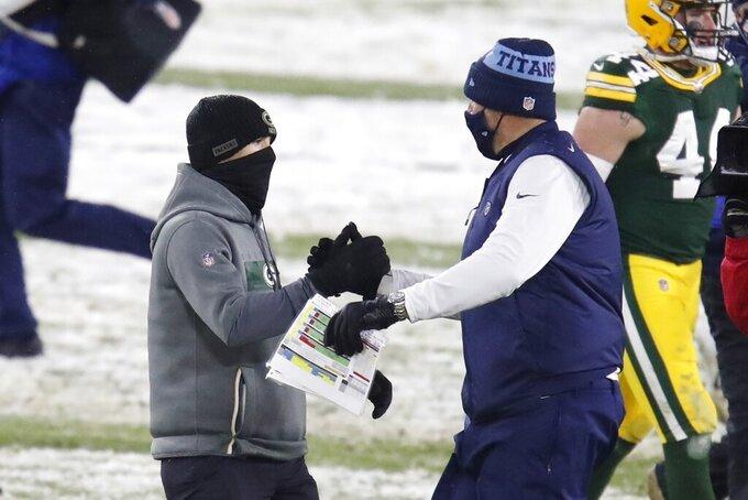 Green Bay Packers head coach Matt LaFleur talks to Tennessee Titans head coach Mike Vrabel after an NFL football game Sunday, Dec. 27, 2020, in Green Bay, Wis. The Packers won 40-14. (AP Photo/Matt Ludtke)