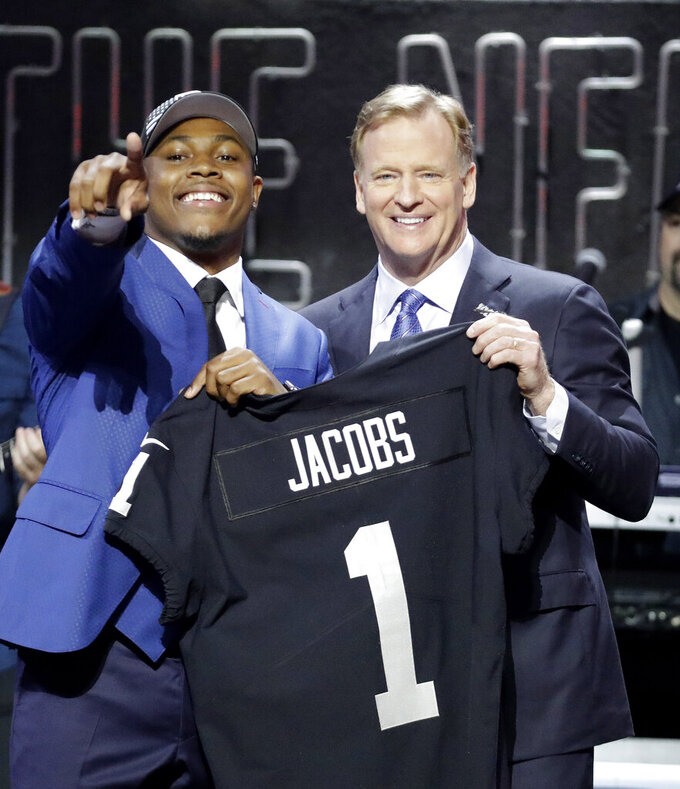 Alabama running back Josh Jacobs poses with NFL Commissioner Roger Goodell after the Oakland Raiders selected Jacobs in the first round at the NFL football draft, Thursday, April 25, 2019, in Nashville, Tenn. (AP Photo/Steve Helber)