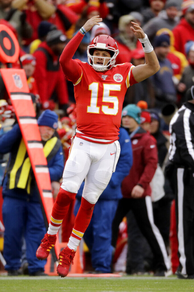 Kansas City Chiefs quarterback Patrick Mahomes (15) reacts during the second half of an NFL football game against the Los Angeles Chargers in Kansas City, Mo., Sunday, Dec. 29, 2019. (AP Photo/Charlie Riedel)
