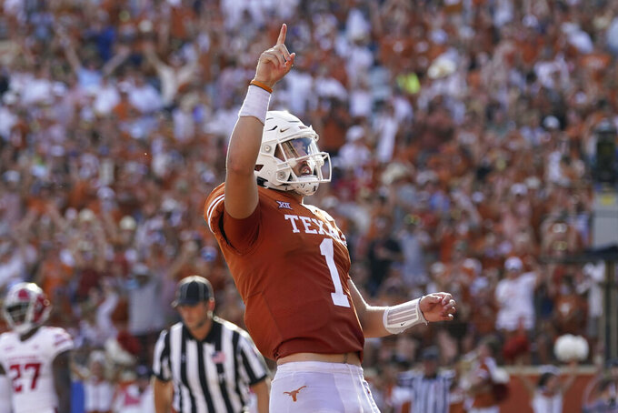 Texas quarterback Hudson Card (1) celebrates after scoring a touchdown against Louisiana-Lafayette during the second half of an NCAA college football game Saturday, Sept. 4, 2021, in Austin, Texas. (AP Photo/Eric Gay)