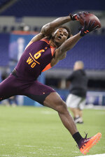 Northern Arizona wide receiver Emmanuel Butler reaches for the ball during a drill at the NFL football scouting combine in Indianapolis, Saturday, March 2, 2019. (AP Photo/Michael Conroy)