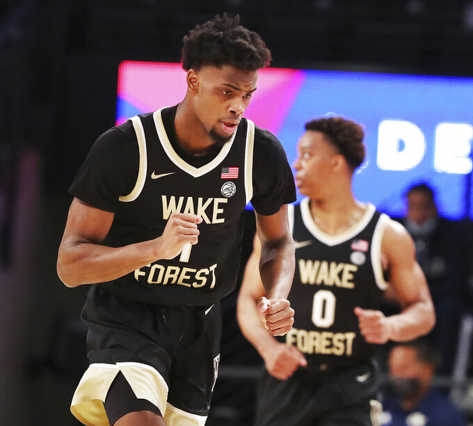 Wake Forest guard Kyle Sturdivant reacts to hitting a three against Georgia Tech during the first half of an NCAA college basketball game on Sunday, Jan. 3, 2021, in Atlanta. (Curtis Compton/Atlanta Journal-Constitution via AP)