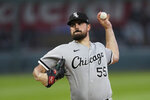 Chicago White Sox starting pitcher Carlos Rodon throws during the first inning of the team's baseball game against the Kansas City Royals on Friday, May 7, 2021, in Kansas City, Mo. (AP Photo/Charlie Riedel)