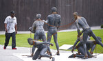 This April 23, 2018, file photo, shows a display at the National Memorial for Peace and Justice in Montgomery, Ala., a new memorial to honor thousands of people killed in racist lynchings. (AP Photo/Brynn Anderson, File)