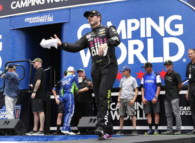 Jimmie Johnson throws a shirt to the crowd during driver introductions before a NASCAR Cup Series auto race at Chicagoland Speedway in Joliet, Ill., Sunday, June 30, 2019. (AP Photo/Nam Y. Huh)