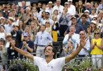 Feliciano Lopez of Spain reacts after defeating Gilles Simon of France 6-2/6-7/7-6 in their men's singles final match at the Queens Club tennis tournament in London, Sunday, June 23, 2019. (AP Photo/Tim Ireland)