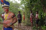 "Sergio Muxi Tembe, chief of the Tekohaw village, stands with members of his tribe as they wait for police to arrive on the Alto Rio Guama indigenous reserve in Para state, Brazil, Wednesday, Sept. 4, 2019. ""We don't want to be killed by bullets,"" he said. ""We want the federal government to assume its responsibility and guarantee the right that we have to live in our lands, to live in peace."" (AP Photo/Luis Andres Henao)"
