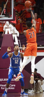 Virginia Tech forward John Ojiako (21) shoots over Duke forward Javin DeLaurier (12) during the first half of an NCAA college basketball game Friday, Dec. 6, 2019, in Blacksburg, Va. (AP Photo/Don Petersen)