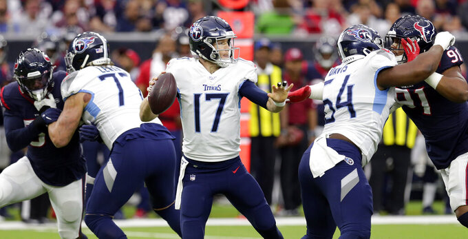 Tennessee Titans quarterback Ryan Tannehill (17) looks to throw a pass against the Houston Texans during the first half of an NFL football game Sunday, Dec. 29, 2019, in Houston. (AP Photo/Michael Wyke)