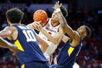 The ball bounces off Oklahoma's Jamuni McNeace (4) as West Virginia's Derek Culver, right, defends during an NCAA college basketball game in Norman, Okla., Saturday, March 2, 2019. (Bryan Terry/The Oklahoman via AP)