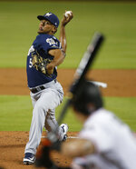 Milwaukee Brewers' Freddy Peralta pitches to Miami Marlins' Derek Dietrich during the first inning of a baseball game Wednesday, July 11, 2018, in Miami. (AP Photo/Wilfredo Lee)