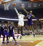 Texas guard Courtney Ramey (3) drives to the basket past TCU guard RJ Nembhard (22) during the second half of an NCAA college basketball game, Saturday, March 9, 2019, in Austin, Texas. (AP Photo/Eric Gay)