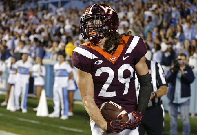 Virginia Tech's Dalton Keene (29) reacts as he runs the ball into the end zone for the game winning touchdown late in the second half of an NCAA college football game against North Carolina in Chapel Hill, N.C., Saturday, Oct. 13, 2018. (AP Photo/Gerry Broome)