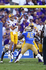 LSU quarterback Max Johnson (14) throws a pass over UCLA linebacker Mitchell Agude (45) during the first half of an NCAA college football game Saturday, Sept. 4, 2021, in Pasadena, Calif. (AP Photo/Marcio Jose Sanchez)