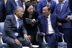 Huawei founder and CEO Ren Zhengfei, right, explains the 5G network system to Malaysian Prime Minister Mahathir Mohamad, left, as Mahathir visits to Huawei Executive Briefing Center in Beijing, Thursday, April 25, 2019. Mahathir is in Beijing to attend the Belt and Road Forum which start on this weekend. (AP Photo/Andy Wong)