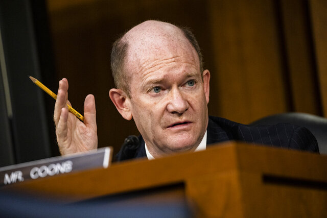 FILE - In this Oct. 15, 2020 file photo Sen. Chris Coons, D-Del., speaks during the confirmation hearing for Supreme Court nominee Amy Coney Barrett, before the Senate Judiciary Committee, on Capitol Hill in Washington. Coons faces political newcomer Lauren Witzke in Delaware's U.S. Senate race. (Samuel Corum/Pool via AP, File)