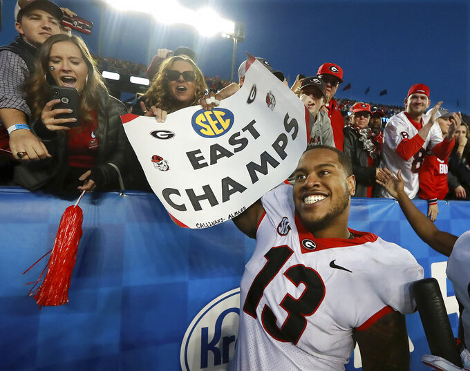 Georgia defensive end Jonathan Ledbetter celebrates a 34-17 victory over Kentucky with the fans to win the SEC East in a NCAA college football game on Saturday, Nov. 3, 2018, in Lexington, Ky. (Curtis Compton/Atlanta Journal-Constitution via AP)