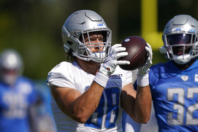Detroit Lions tight end T.J. Hockenson catches during a drill at the Lions NFL football camp practice, Saturday, Aug. 22, 2020, in Allen Park, Mich. (AP Photo/Carlos Osorio)