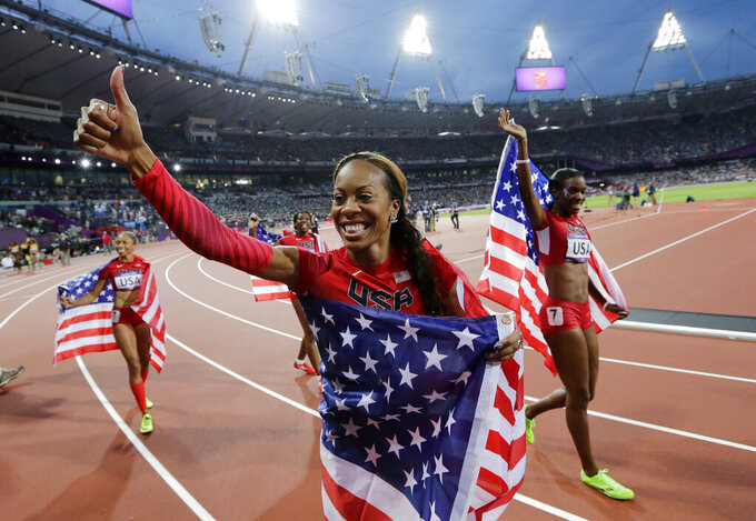 FILE- In this Aug. 11, 2012, file photo, United States' Deedee Trotter, right, Sanya Richards-Ross, front center, and Allyson Felix, back left, celebrate winning gold in the women's 4x400-meter relay final during the athletics in the Olympic Stadium at the Summer Olympics in London. Richards-Ross will provide fashion and lifestyle commentary of the Kentucky Derby on NBC on May 1. The network is announcing her addition to its coverage Tuesday morning. April 20, 2021. (AP Photo/David J. Phillip, File)