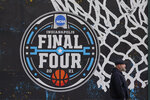 The NCAA Final Four logo for the NCAA college basketball tournament is painted on a window in downtown Indianapolis, Wednesday, March 17, 2021. (AP Photo/Darron Cummings)