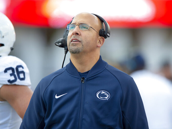 Penn State head coach James Franklin watches a replay on the stadium screen during the second half of an NCAA college football game Saturday, Oct. 20, 2018, in Bloomington, Ind. Penn State won 33-28. (AP Photo/Doug McSchooler)