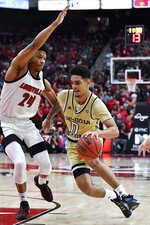 Georgia Tech forward Jehloni James (24) drives on the defense of Louisville forward Dwayne Sutton (24) during the first half of an NCAA college basketball game in Louisville, Ky., Wednesday, Jan. 22, 2020. (AP Photo/Timothy D. Easley)