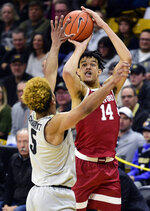 Stanford's Spencer Jones shoots over Colorado's D'Shawn Schwartz during the first half of an NCAA college basketball game Saturday, Feb. 8, 2020, in Boulder, Colo. (AP Photo/ Cliff Grassmick)