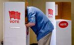 Voter John Parker fills in his ballot at Canadian Hills Church of the Nazarene on Tuesday, June 30, 2020, in Oklahoma City, Okla. (Chris Landsberger/The Oklahoman, via AP)