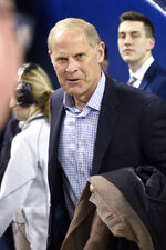Former Michigan coach John Beilein makes his way to his seat before Michigan's NCAA college basketball game against Nebraska, Thursday, March 5, 2020, in Ann Arbor, Mich. (AP Photo/Jose Juarez)