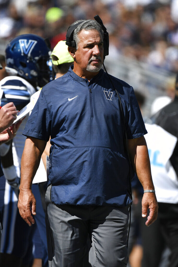 Villanova head coach Mark Ferrante walks the sideline during an NCAA college football game against Penn State in State College, Pa., on Saturday, Sept. 25, 2021. (AP Photo/Barry Reeger)