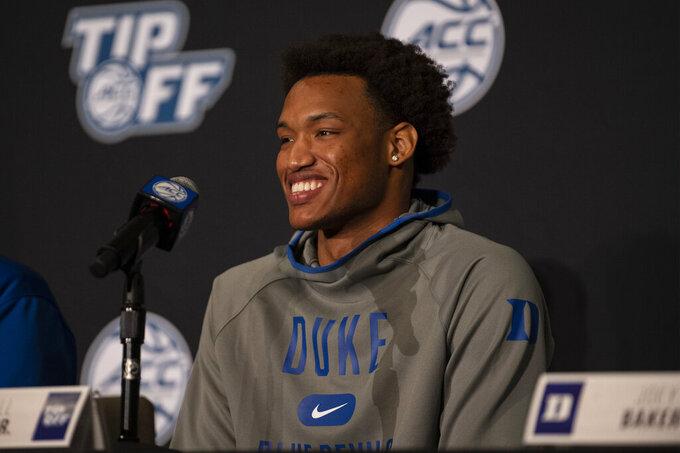Duke forward Wendell Moore Jr. smiles during NCAA college basketball ACC Media Day, Tuesday, Oct. 12, 2021, in Charlotte, N.C. (AP Photo/Matt Kelley)