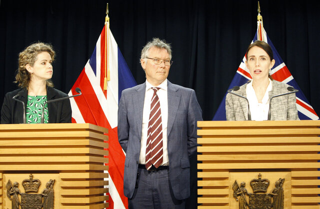 British High Commissioner to New Zealand Laura Clarke, left, New Zealand's Trade Minister David Parker, center, and New Zealand's Prime Minister Jacinda Ardern, right, talk to reporters on Wednesday, June 17, 2020, in Wellington, New Zealand. Both Australia and New Zealand announced Wednesday they are starting free-trade talks with the United Kingdom, as each country seeks to rekindle a trading relationship that was severely tested nearly 50 years ago. (AP Photo/Nick Perry)