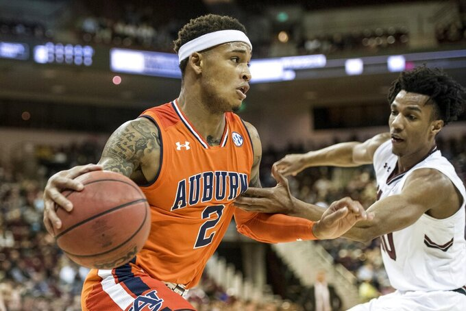 Auburn guard Bryce Brown (2) drives to the hoop against South Carolina guard A.J. Lawson (00) during the first half of an NCAA college basketball game Tuesday, Jan. 22, 2019, in Columbia, S.C. (AP Photo/Sean Rayford)